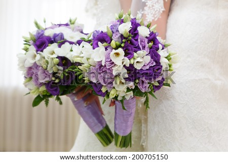 A bouquet of flowers at a wedding in the hand of the bride.