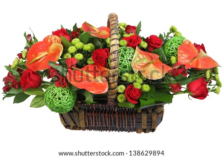 A bouquet of flowers in a wicker basket, red anthurium, spray chrysanthemum, red rose. Floristic composition, flower arrangement, Isolated image on white background. - stock photo