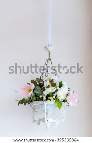 a bouquet of flowers in the hanging flowerpot - stock photo