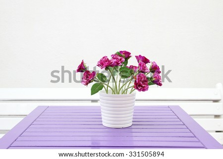 A bouquet of flowers on a wooden table - stock photo