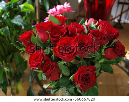 a bouquet of roses shown in a home setting
