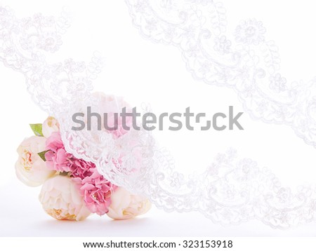 A bouquet with lace curtain. Wedding invitation, lace veil textile.  - stock photo