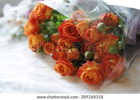 A bouquet with orange roses. A festive bouquet of flowers for your congratulations dear people. The feast and gifts. The anniversary bouquet of roses.