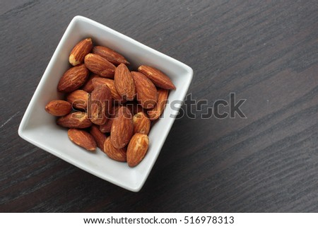 A bowl full of almond nuts.