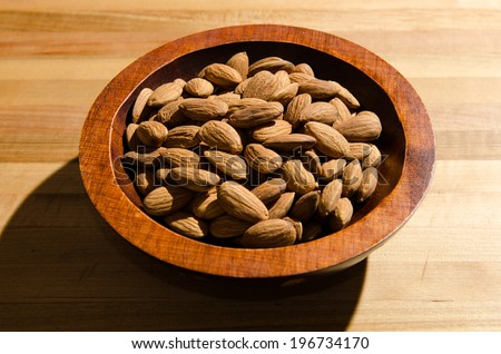 A bowl of almonds - stock photo