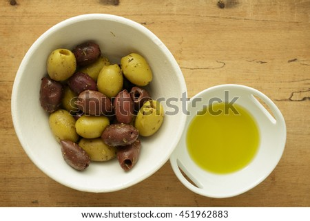 A bowl of assorted Greek Olives and olive oil.