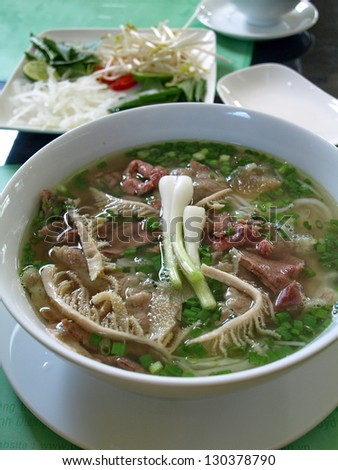 a bowl of beef & rice vermicelli soup, vietnamese noodle cuisine - stock photo