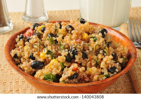 A bowl of black bean and quinoa salad - stock photo