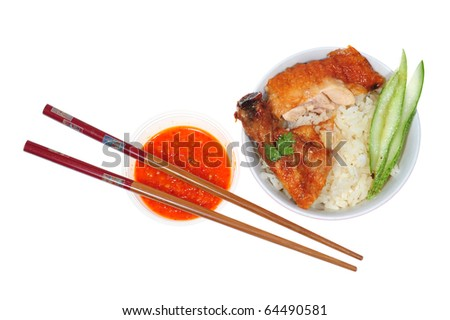 A Bowl Of  Chicken Rice With Chopstick And Chili