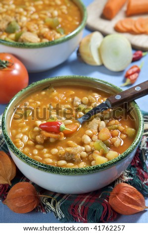A bowl of chili beans and vegetables - stock photo
