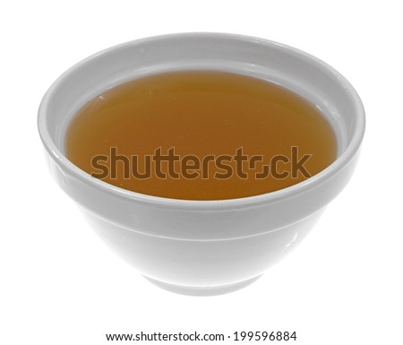 A bowl of clear chicken broth on a white background. - stock photo