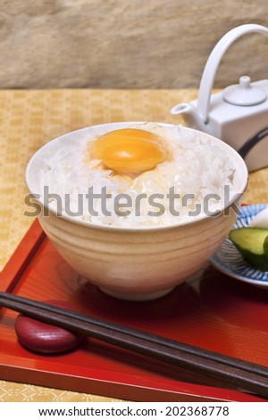 A Bowl Of Cooked Rice With An Egg On It