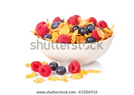 A bowl of cornflakes with fruits on white background. Shallow depth of field