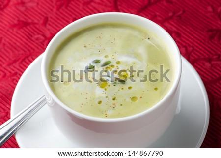 A bowl of cream of asparagus soup - stock photo