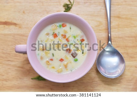 A bowl of creamy vegetable soup with  Spoon soup,top view - stock photo