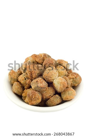 A bowl of delicious crunchy fresh southern fried okra in a bowl, isolated on a white vertical background