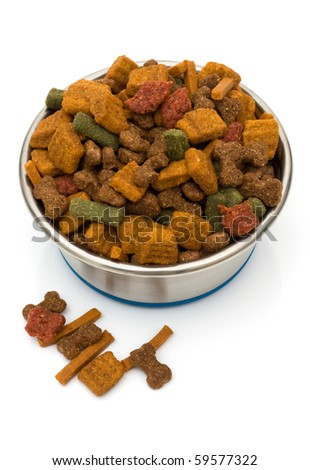 A bowl of dog food isolated on a white background, dog treats - stock photo