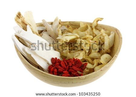 A bowl of Dried Chinese herb, to make soup, isolated on white - stock photo