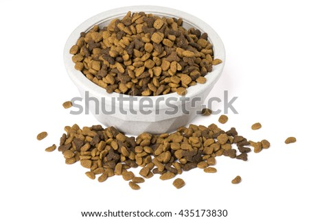 A bowl of dry cat food overflowing, isolated on white with shadows.