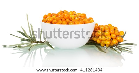 A bowl of fresh berries and buckthorn bunch isolated on white background. - stock photo