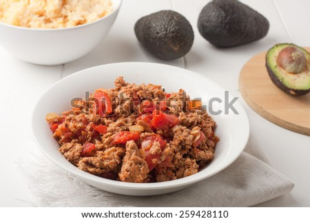 a bowl of fried ground meat with tomatoes for tacos - stock photo