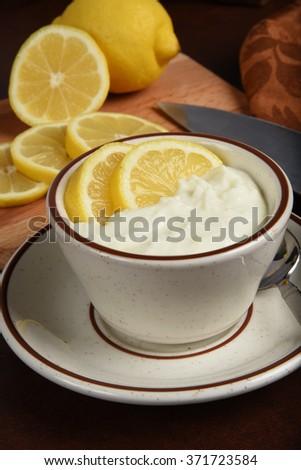 A bowl of Greek style lemon yogurt  - stock photo