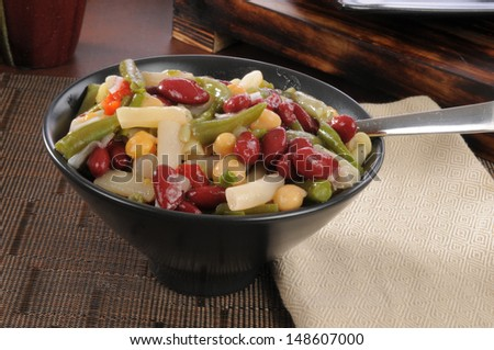 A bowl of healthy four bean salad - stock photo