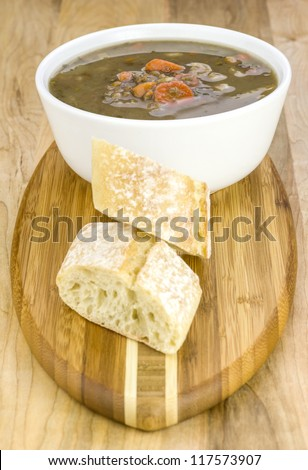 a bowl of hearty lentil soup and bread