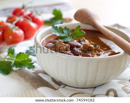 A bowl of homemade chili kidney bean soup with meat - stock photo