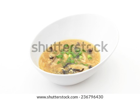 A bowl of Hot and Sour Soup on a white background. - stock photo