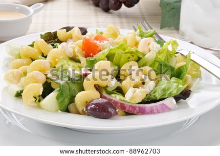 A bowl of Mediterranean pasta salad with greek olives and feta cheese