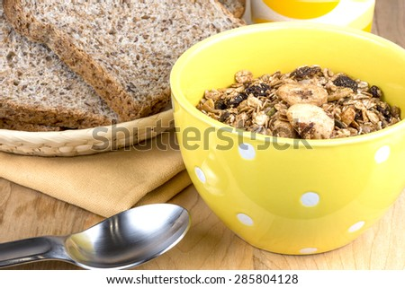 A bowl of muesli cereal and high fiber bread - stock photo