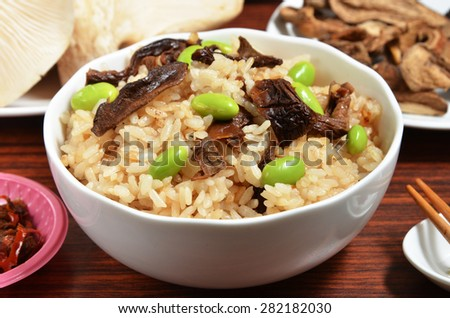 A bowl of porcino rice on the table - stock photo