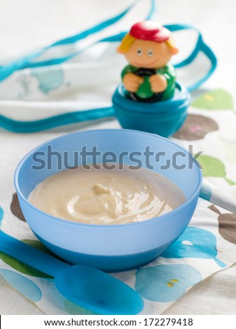 A bowl of porridge for baby. Shot for a story on homemade, organic, healthy baby food - stock photo