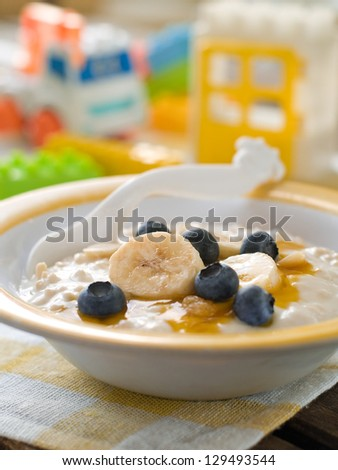 A bowl of porridge for baby. Shot for a story on homemade, organic, healthy baby foods. - stock photo