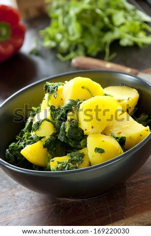 A bowl of Saag Aloo an Indian Restaurant cuisine dish