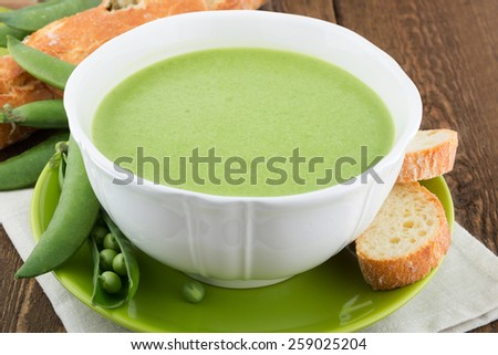 A bowl of soup on a rustic background - stock photo