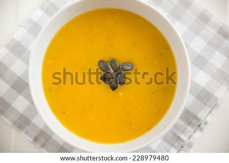 A bowl of spicy pumpkin soup - stock photo