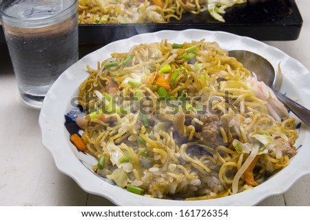A bowl of steaming food with beverage. - stock photo