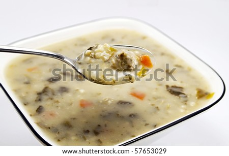 A bowl of traditional Italian Meatball and vegetable wedding soup - stock photo