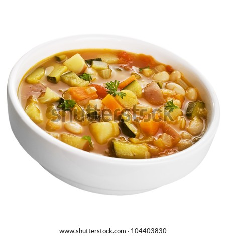 A bowl of vegetable soup isolated on white. - stock photo