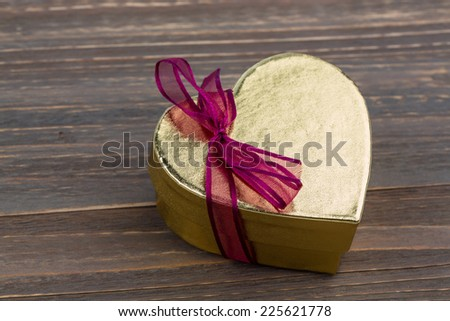 a box for a gift in the shape of a heart. symbol photo for valentine's day, wedding anniversary, engagement. - stock photo