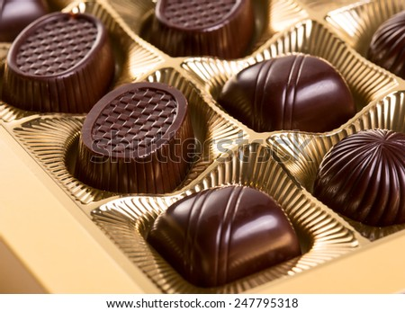 A box of various chocolate candies - stock photo