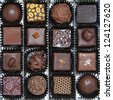 A box of various chocolate pralines - the photo is taken above - stock photo