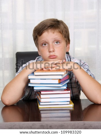 A boy and a books - stock photo