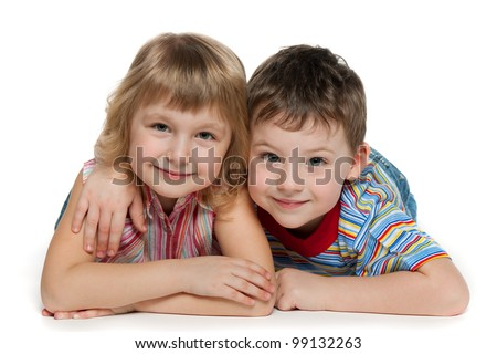 A boy and a girl are lying together; isolated on the white background