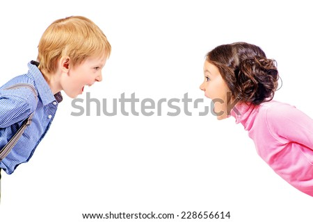 A boy and a girl looking at the camera and shouting. Isolated over white. - stock photo