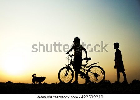 A boy and Woman fitness silhouette sunrise cycling workout wellness concept.
