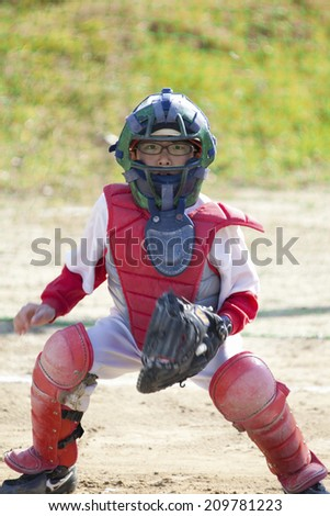 A Boy Baseball Catcher