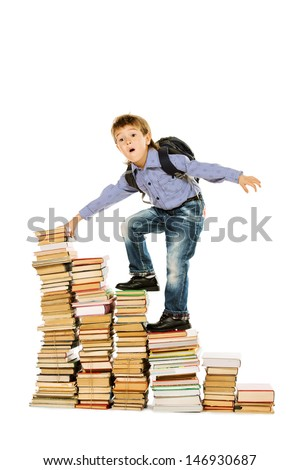 A boy climbing the stairs of books. Education. Isolated over white.